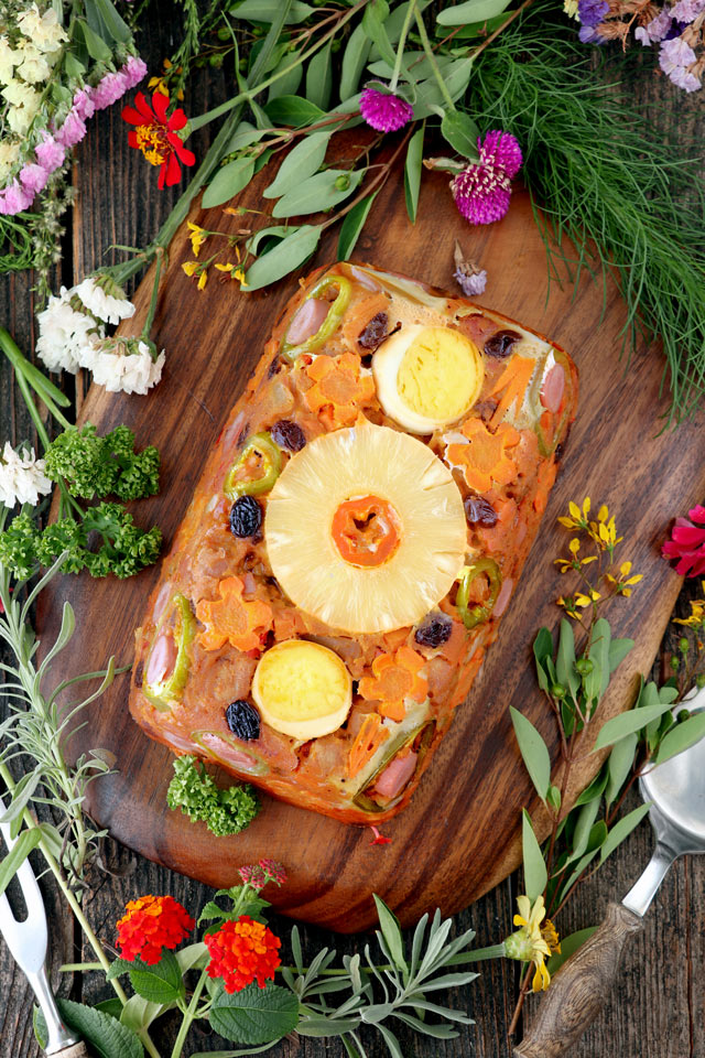 Meatloaf made from pork cubes with pineapple, carrots, raisins, bell pepper.