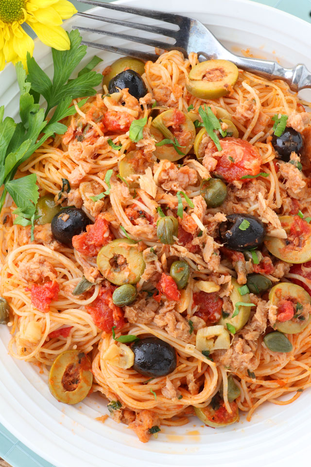 Spicy Italian pasta with tomatoes, olives, capers, garlic.