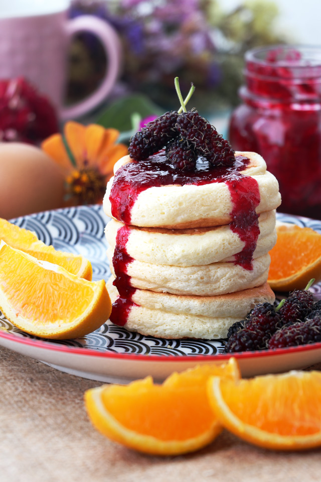Fluffy pancakes with jam and fruits
