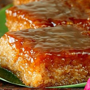 Filipino sticky rice cake with coconut caramel topping