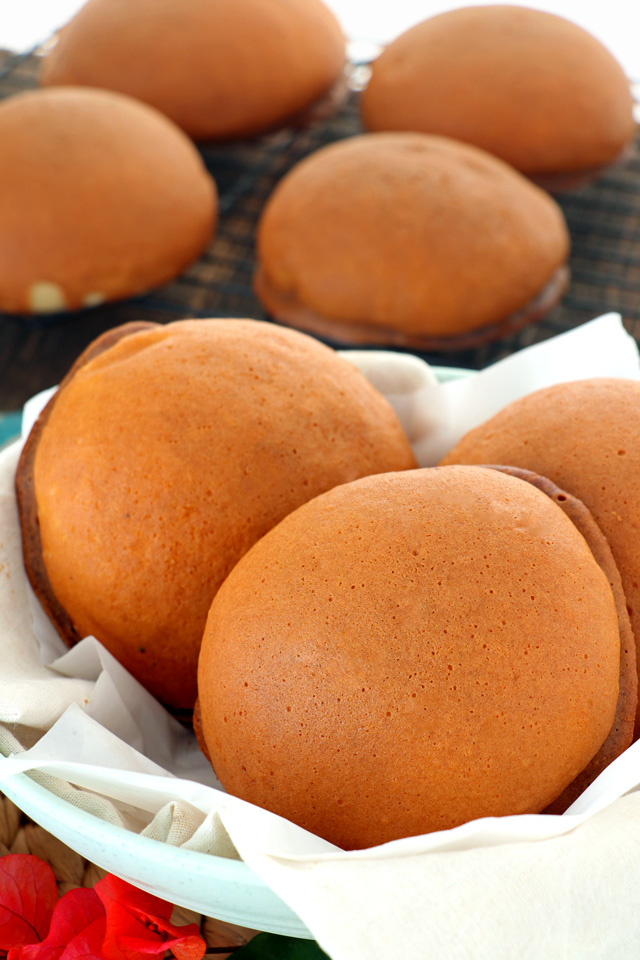 Freshly baked Kopi Roti or coffee buns on a basket