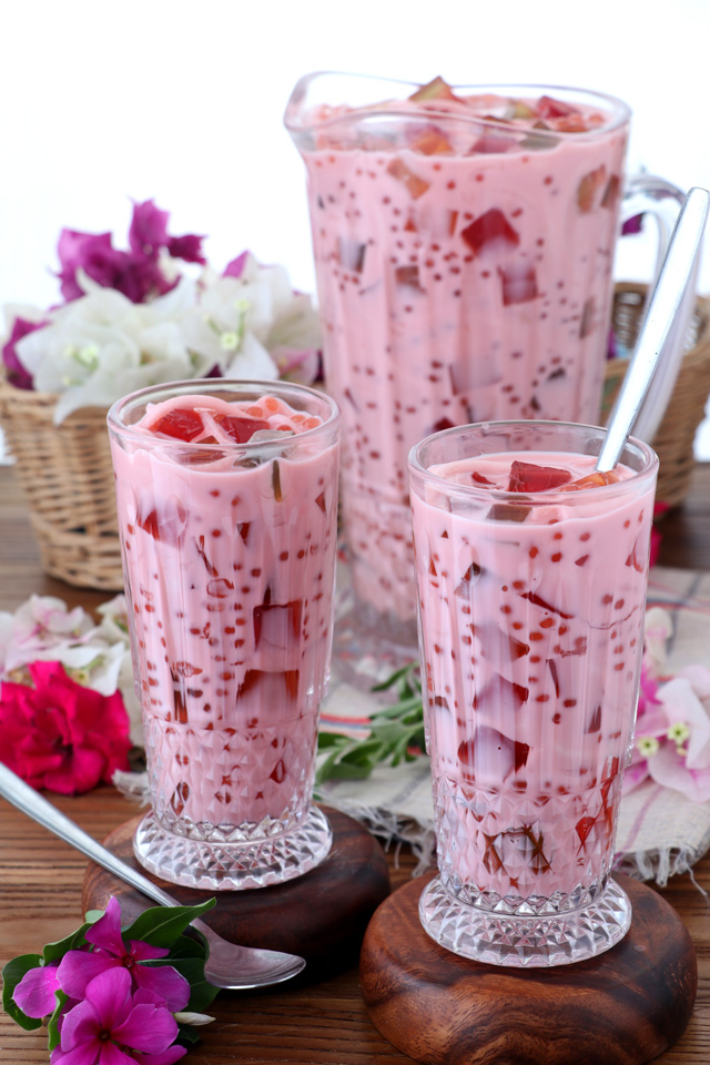 a cold drink with coconut juice, milk and colorful jelly and