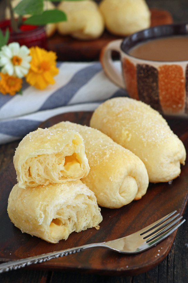 Super soft, sweet rolls with cheese filling coated with butter and sugar.