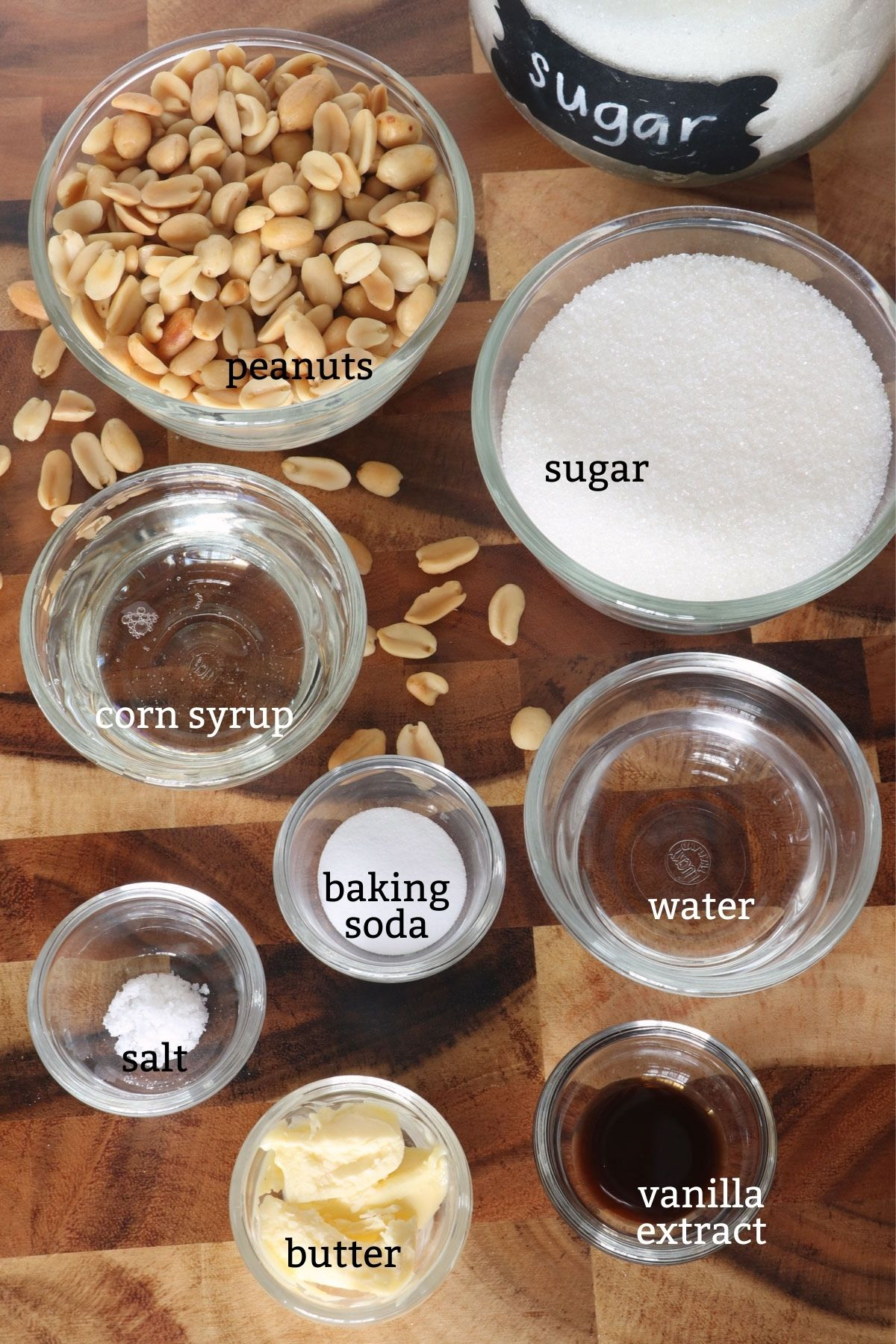 ingredients for peanut brittle: peanut, sugar, corn syrup, water, butter, salt, vanilla extract, baking soda