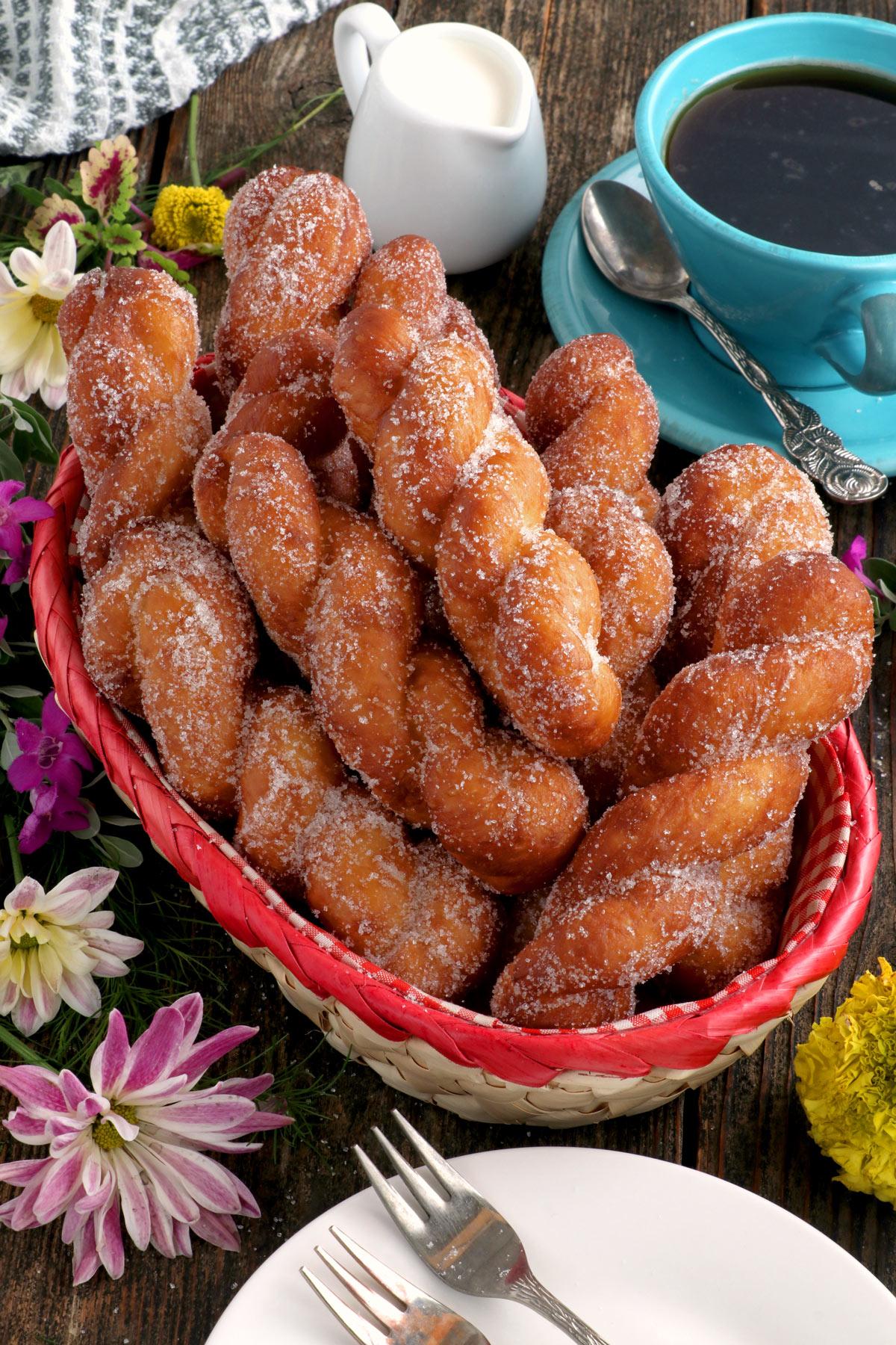 Bicho-bicho or Filipino twisted donuts served on a basket