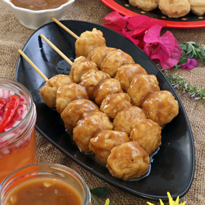 Homemade fish balls on sticks fried and dipped in special Manong's sauce.