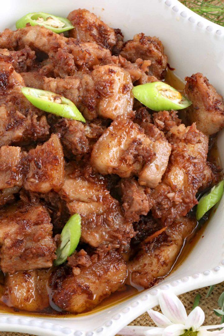 Pork Binagoongan is a Filipino pork dish cooked with shrimp paste.