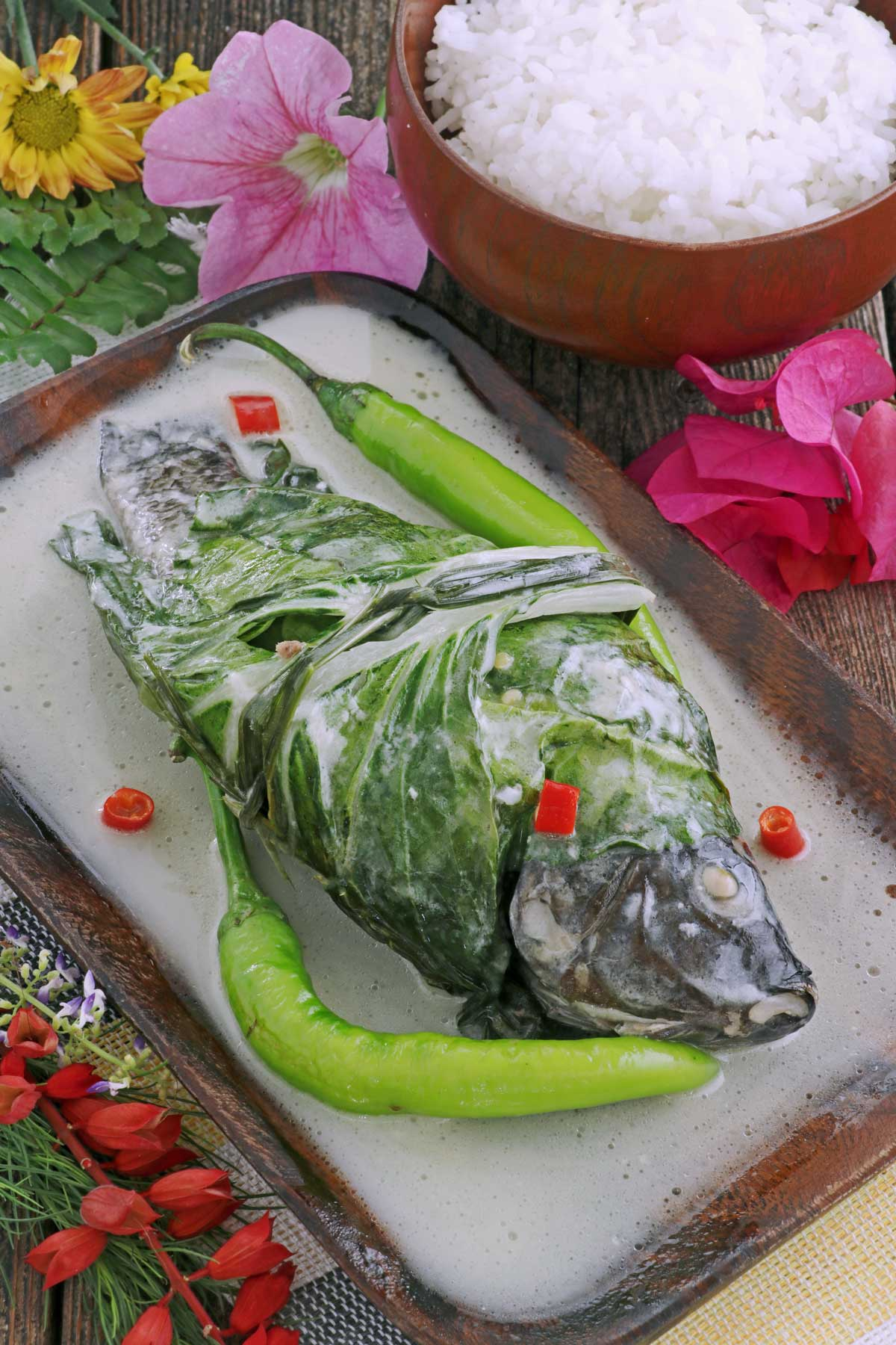 Stuffed Tilapia wraped in bok choy then cooked in coconut milk.