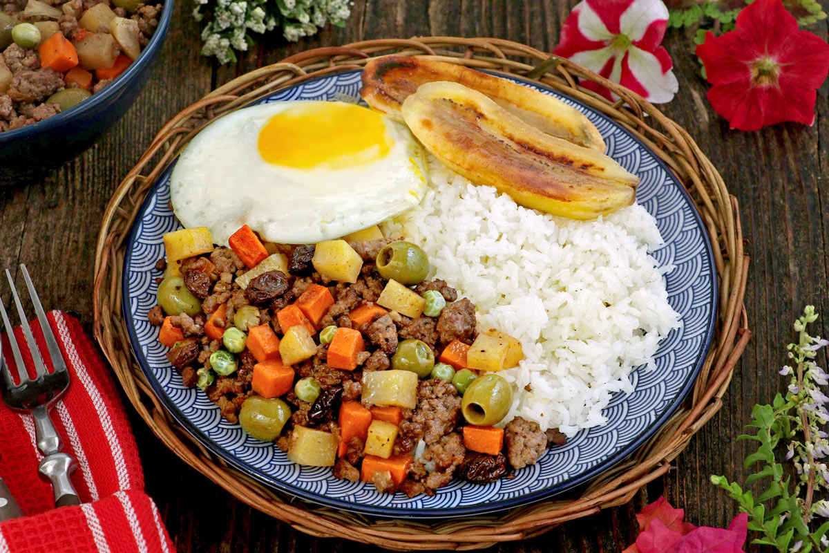 Arroz ala Cubana - a serving of rice, cooked ground meat, fried egg and fried bananas.