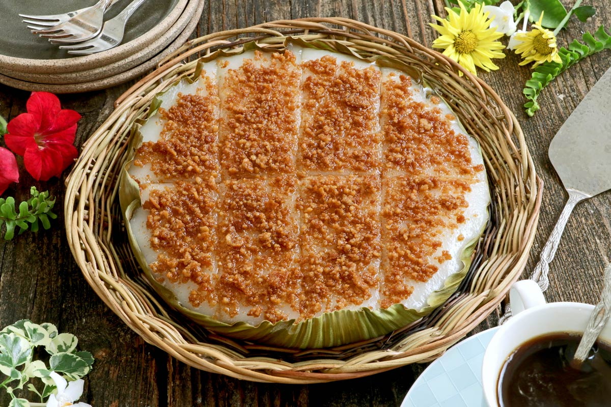 A Filipino steamed sticky rice delicacy with coconut curds.