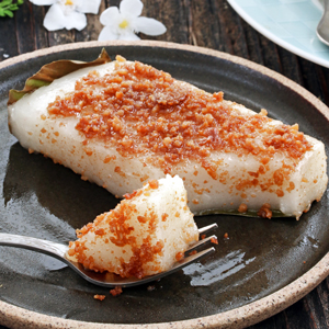 steamed sticky rice cake with coconut curd toppings.