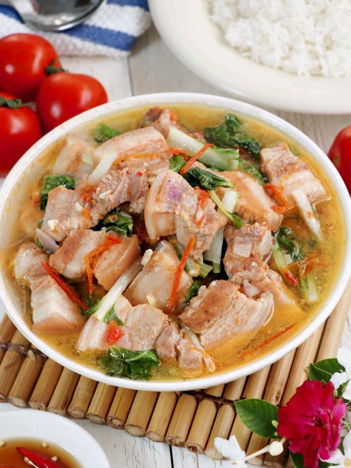Kinamatisang baboy in a soup bowl.