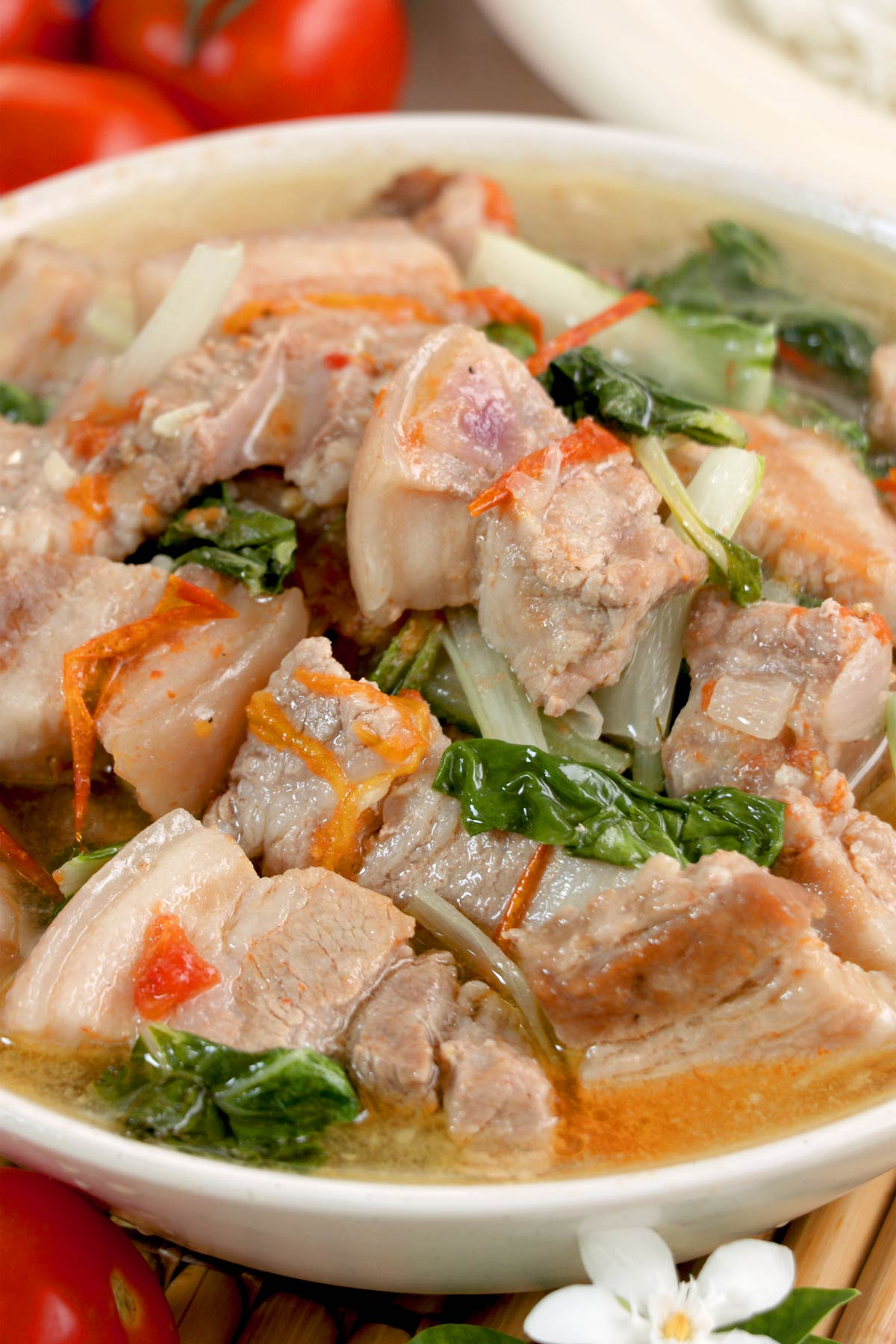 Pork soup with tomatoes and bok choy.
