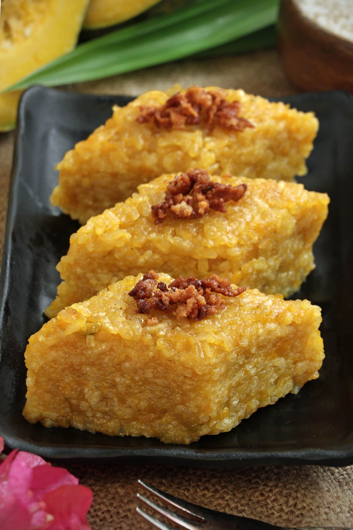 Biko Kalabasa or Sticky Rice Cake with squash cut into squares for serving.