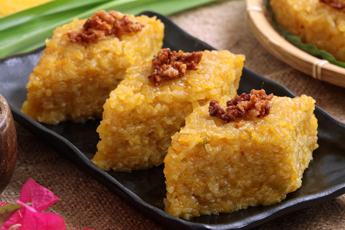 Biko Kalabasa cut into serving sizes, topped with latik.