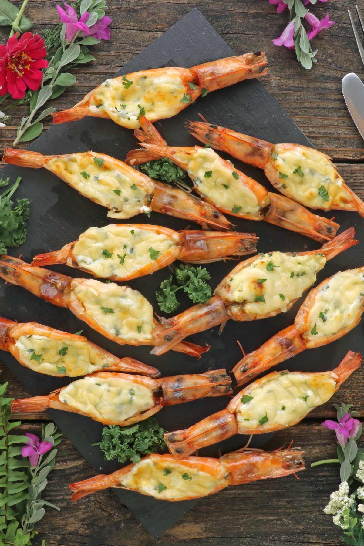 Cheesy baked butterflied shrimp.