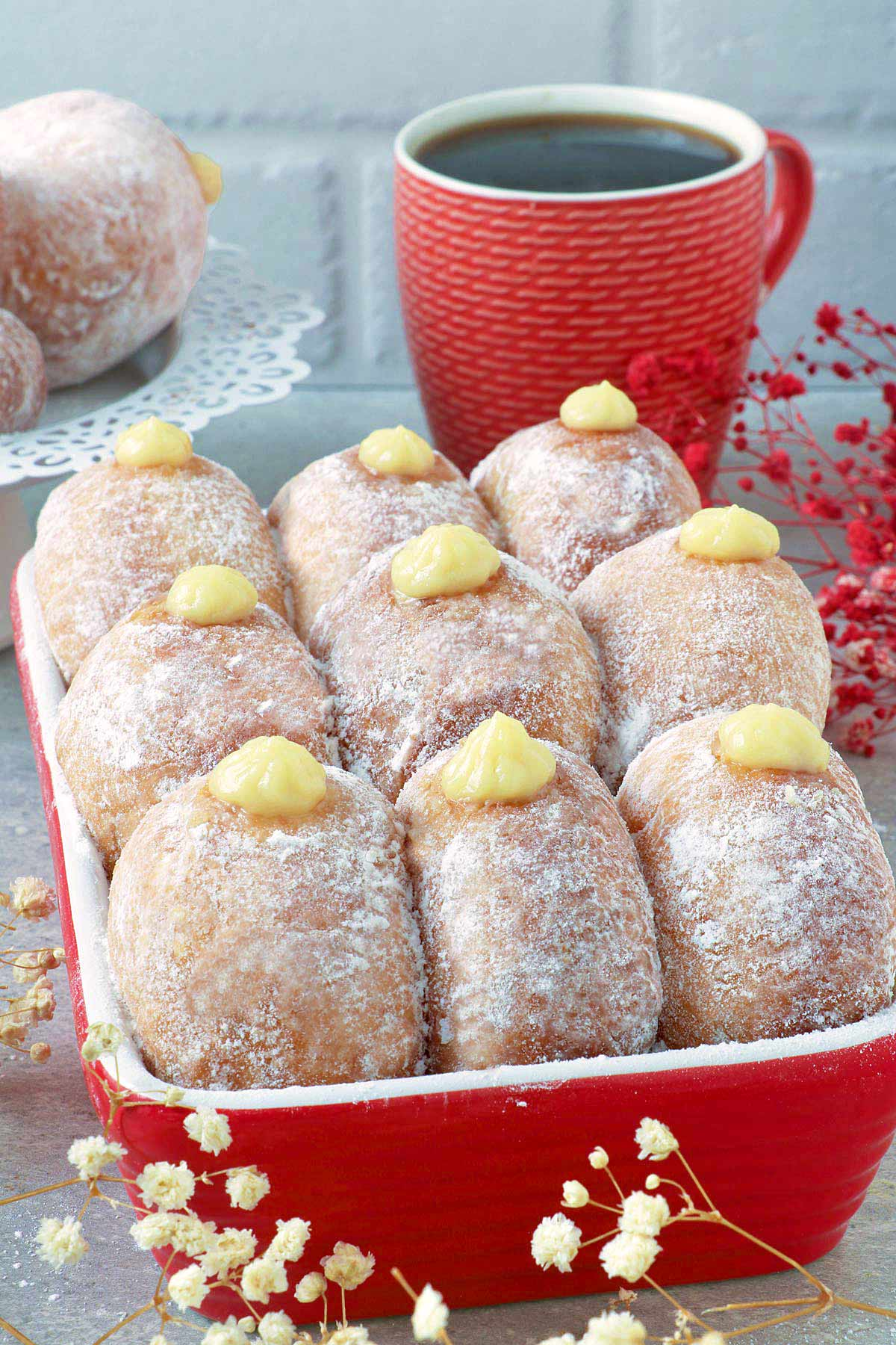 Donuts filled with bavarian cream on a box.