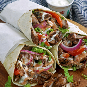 Chicken Shawarma with tomatoes, onions, lettuce and yougurt-garlic sauce.