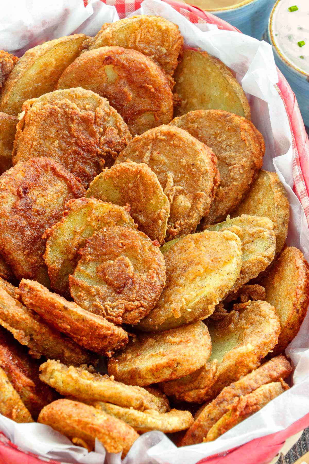 Golden Crispy Mojo Potatoes served in a basket.