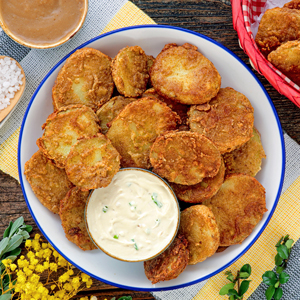 Crispy fried mojo potatoes with dip.