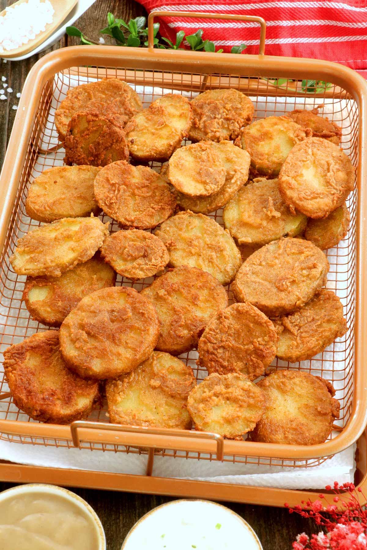 Freshly fried crispy mojo potatoes.