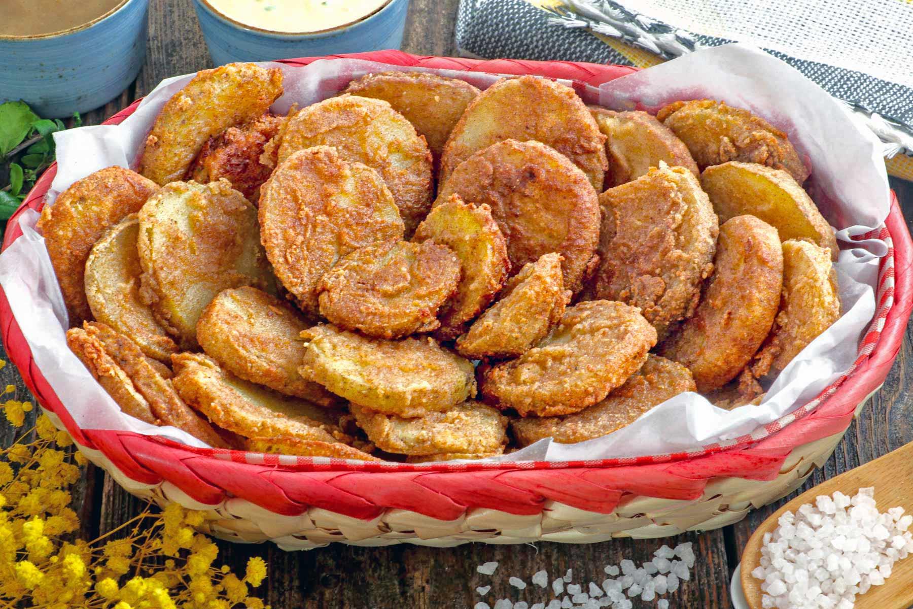 Crispy fried breaded potato slices.